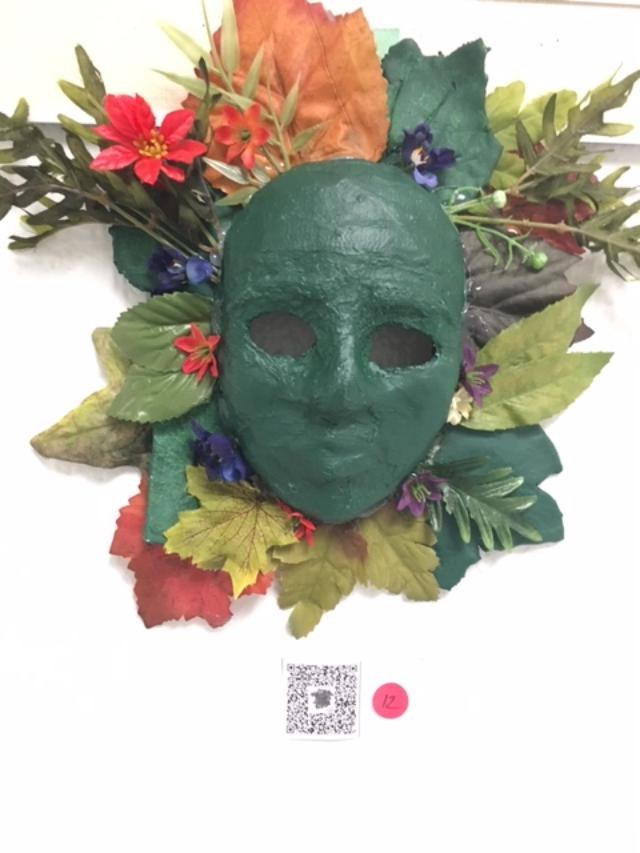 green mask with bouquet