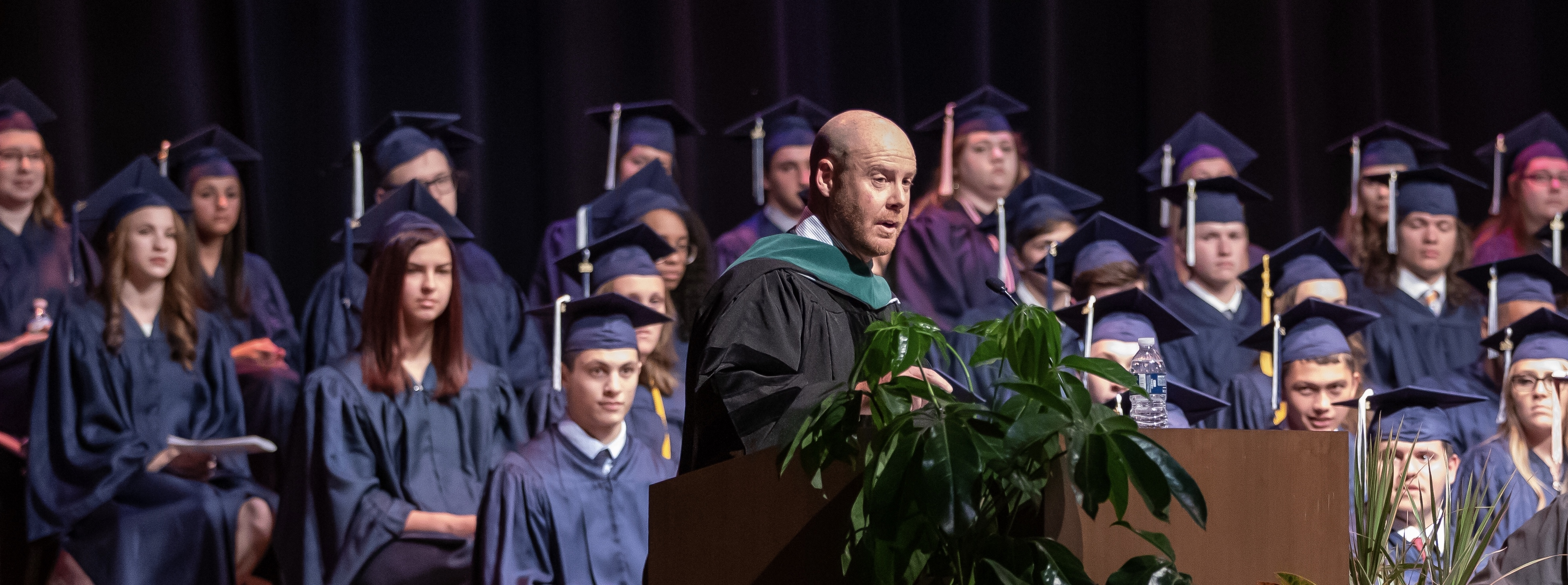 doctor michael karch at the podium at 2019 graduation
